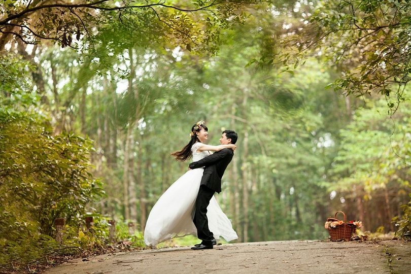 Newlyweds embracing in nature