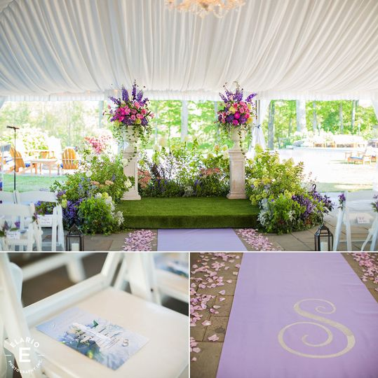 Tented garden ceremony with monogrammed isle runner.