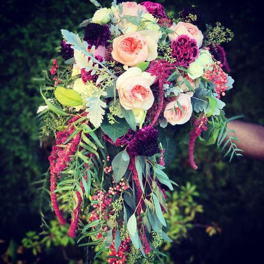 Garden inspired cascade bouquet of roses, berries, pods, garden flowers