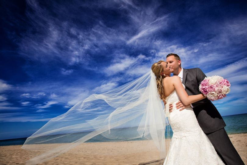 Kissing his bride