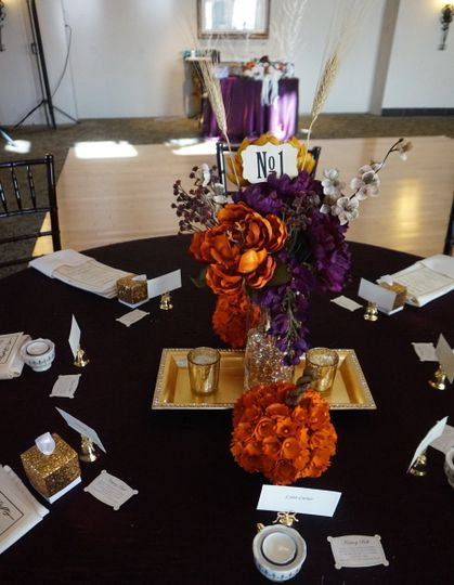 DIY Fall Wedding with orange and purple accent colors.