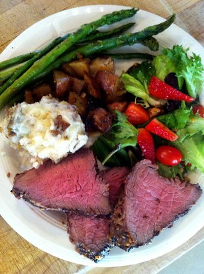 Grilled Tri tip beef roast with garlic mashed and red roasted potatoes, asparagus, & a mixed greens...