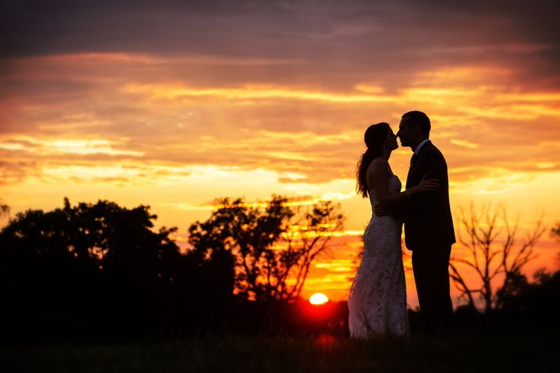 kelly bride and groom sunset silhouette