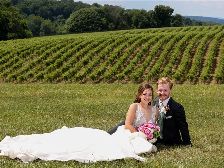 Tmx Bride And Groom Sitting Down Wide Shot Vineyard 51 1035 Mount Airy, MD wedding venue