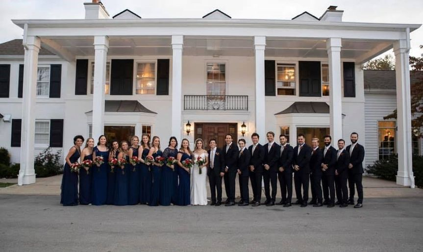 Wedding party in front of an estate