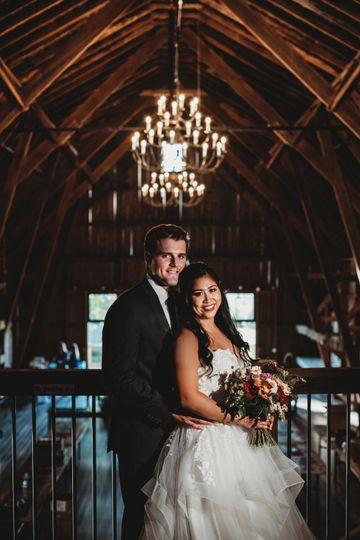 Couple on balcony in barn