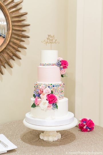Buttercream wedding cake with custom sprinkles and fresh florals