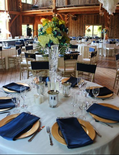 Barn wedding & reception in Ivory, Navy and Gold.