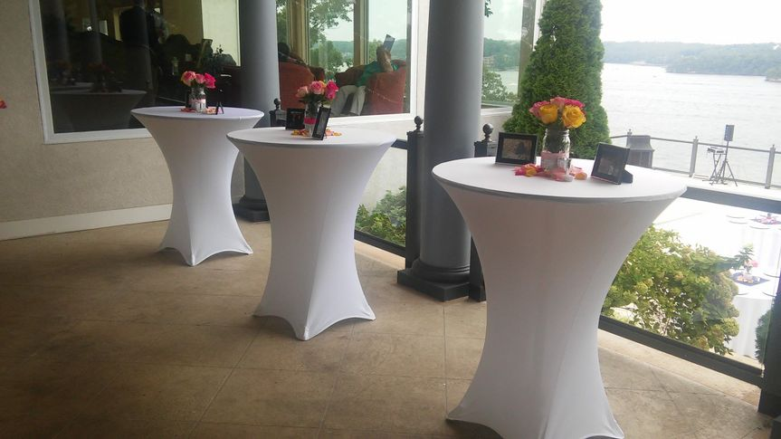 Cocktail tables on balcony at wedding