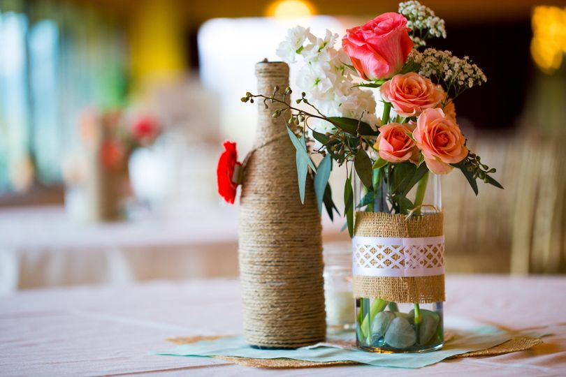 Chic rustic centerpiece with roses and other filler.