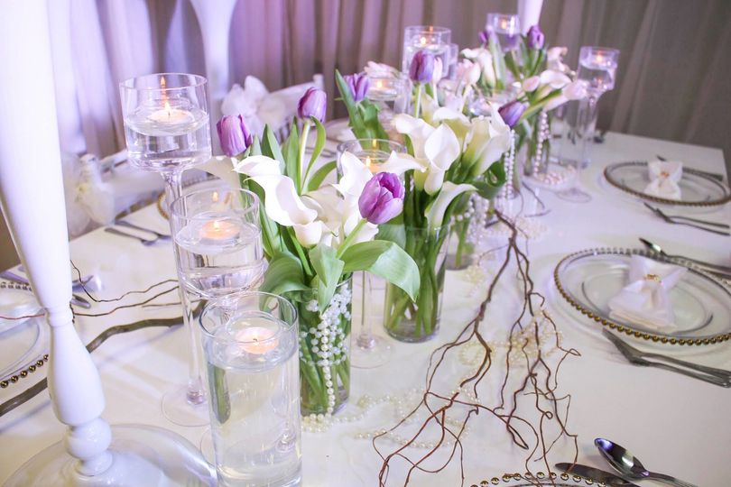 Cluster of Ivory Calla Lillies with pops of color in the tulips accented with pearls, curly willow...