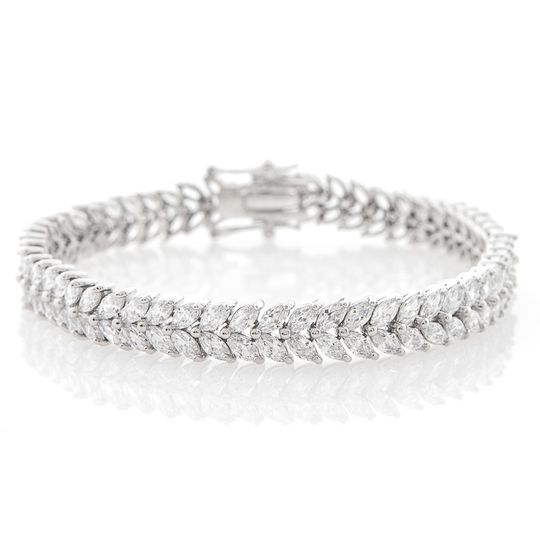 CLARA LEAF BRACELET  This handcrafted rhodium plated bracelet is embellished with marquis-cut cubic...