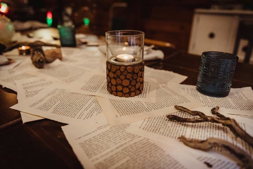 Books, wood, and paper by candlelight.
