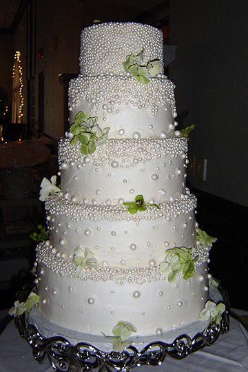 Intricately pearled wedding cake with vinework.