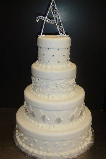 Amazing all white cake with varying textures and pearling across layers.