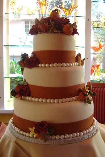3 tier, thanksgiving themed cake--beautiful cornucopia of pumpkins, flowers and vines handcrafted...