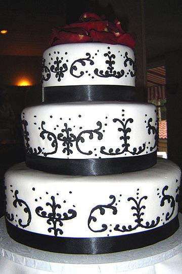 Elegant swirls black and white cake with huge rose topping!