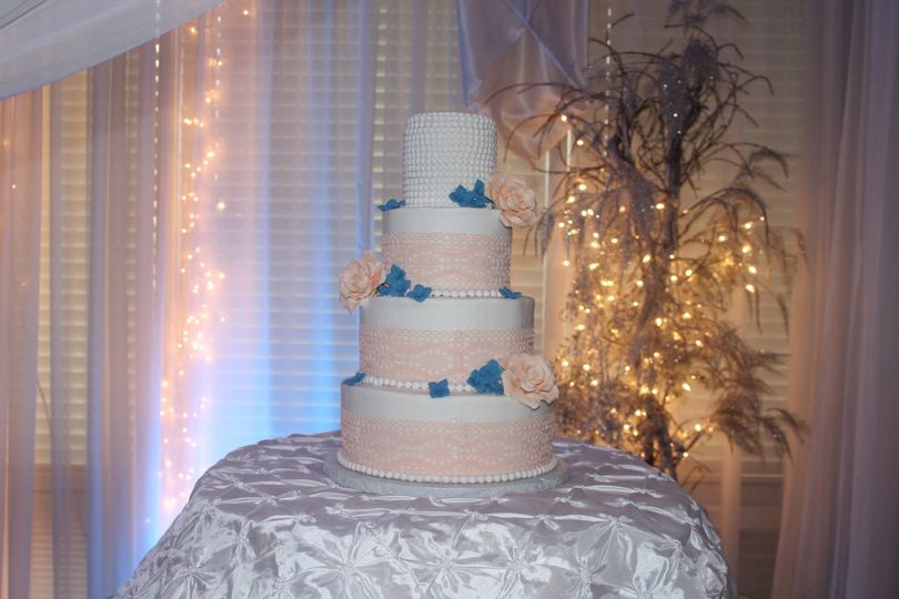 Simple and clean 4 tier cake with flower accents!