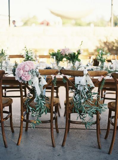 Chair decorations with Olive branches and Ivory Ribbon