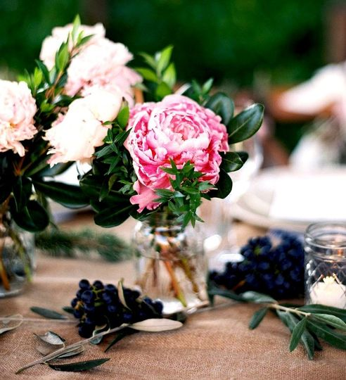 Peonies, pittosporum and myrtle table arrangements
