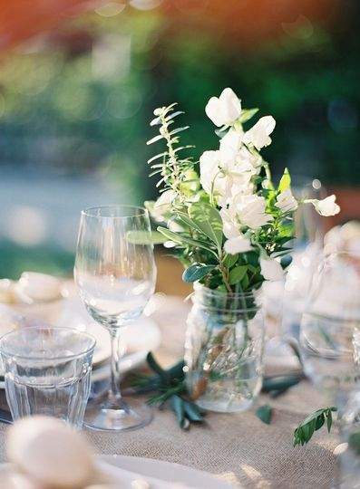 Table arrangement with Sweet Peas, Myrtle, Eucalyptus, and Pittosporum