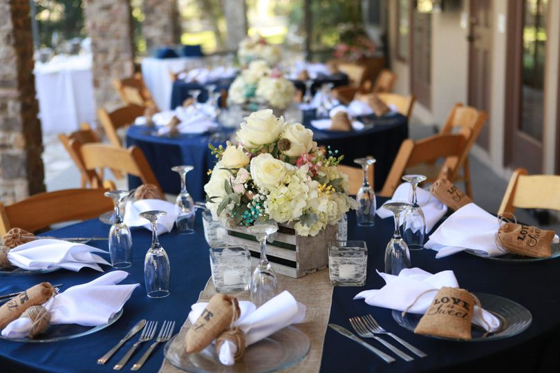 Navy reception tables and floral centerpieces