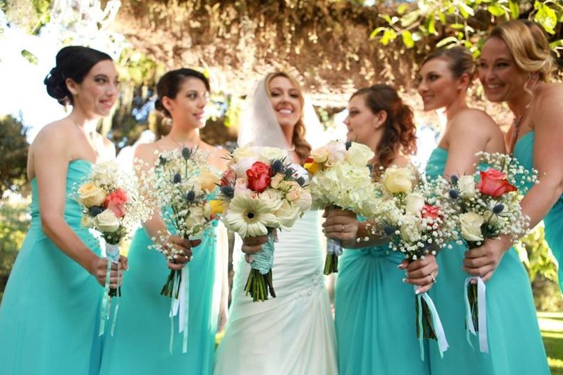 Bride and her bridesmaids holding their bouquets