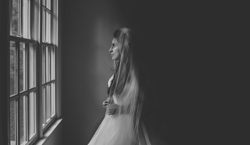 Bride gazing out window