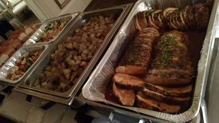 Ochoa's Steamship Carving station sides and a pork loin in a adobo sauce .