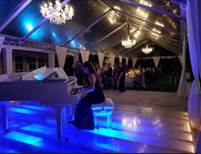 Pianist on Glass Covered Pool