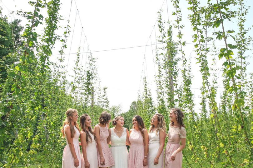 Bride, maid of honor, and bridesmaids in the field