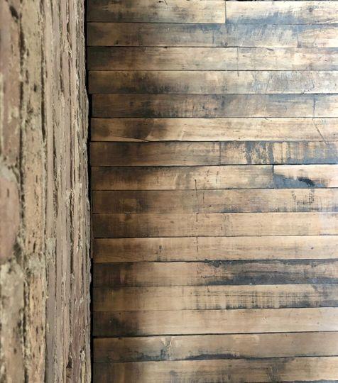 Exposed brick and wood floor