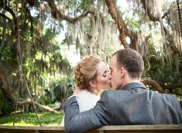 Perfect location for an outdoor wedding under the Mossy Oaks with the lake in the backdrop