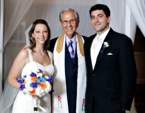 Newlyweds with the rabbi