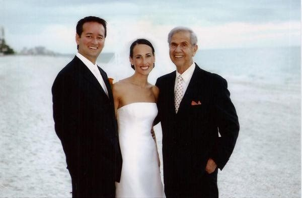 Newlyweds and the rabbi at the beach