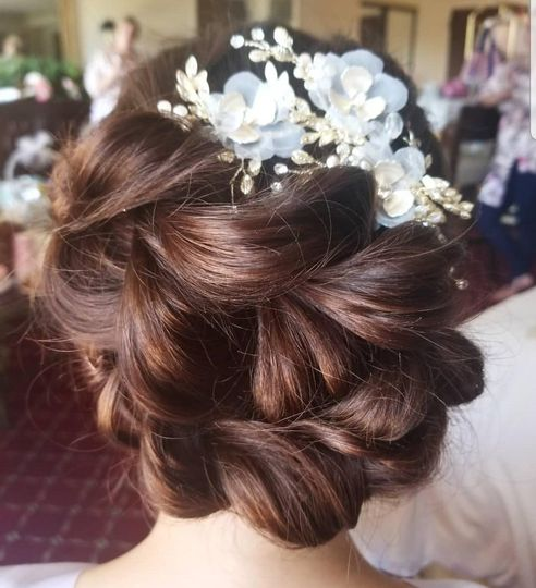 Flower updo - Top Knot Bridal