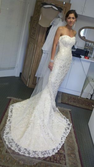 Gown designed by Rose DeSimone created in Silk Dupioni with lace overly and hand beaded Swarovski...
