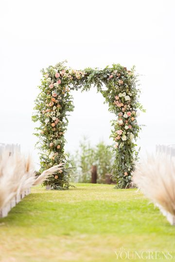Floral arch with pampas aisle