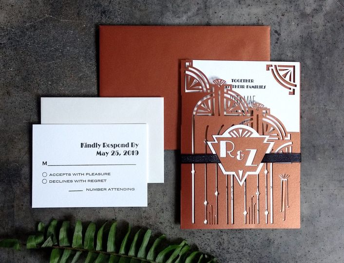 Invitation with laser cut wrap