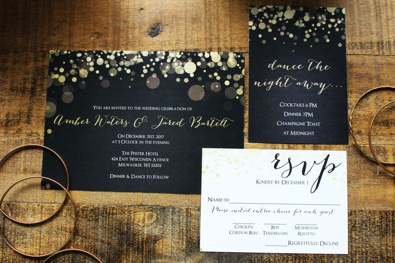 Black invitation with gold bits