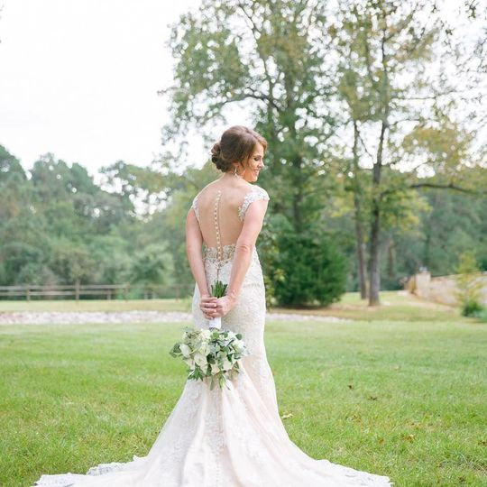 Bride in a backless wedding dress