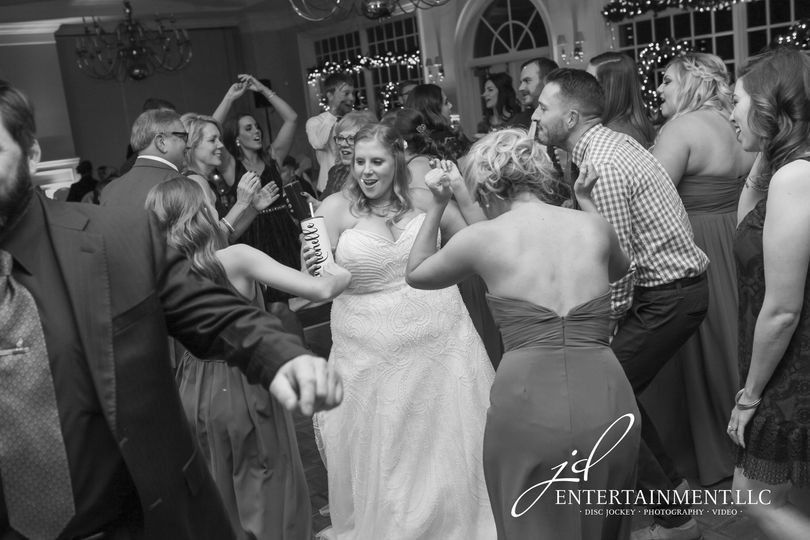 Newlyweds dancing with their guests