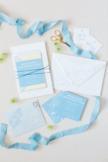 Flourishing Penguin lemon yellow and french blue floral invitations