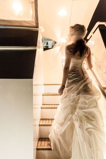 Beautiful photo of Bride on the Lower Deck of ICON.  Photo by Kip Roof