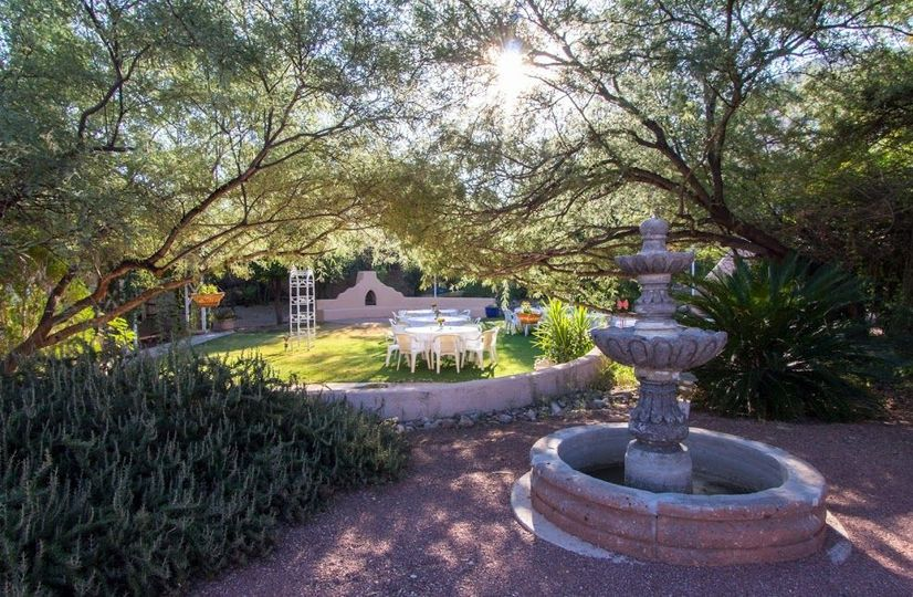 Lush green garden with water fountains