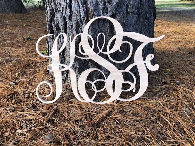 Monogram signs in the woods