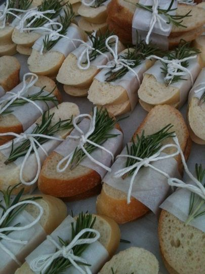Preset Bread with parchment, twine and rosemary garnish