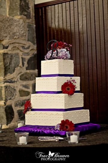 4-tier Offset Square cake in Swiss Meringue Buttercream with Piping, Swiss Dots & Fresh Flowers