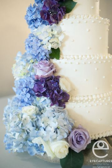 Cascade Flowers & Swiss Dots Wedding CakePhoto by: Eyecaptures Photography