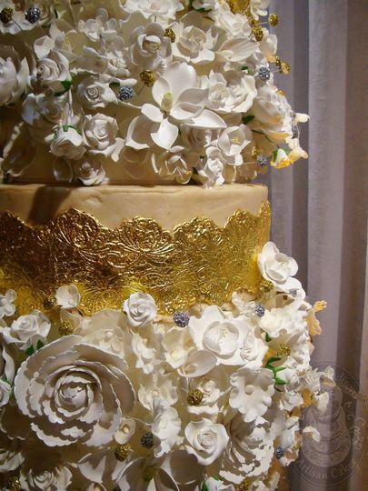 dsc05655wm gold leaf and flowers wedding cake larg